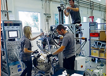 Three technicians working on a Scienta Omicron system  | © Scienta Omicron