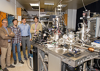 Team of people standing with the LT Nanoprobe System  | © Jozef Stefan Institute